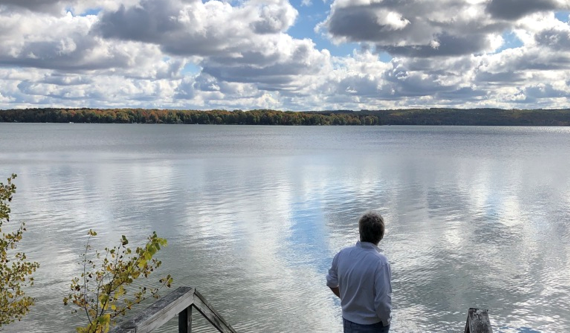 John Kralik at the edge of a lake